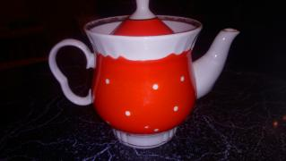 Beautiful red kettle in white dots
